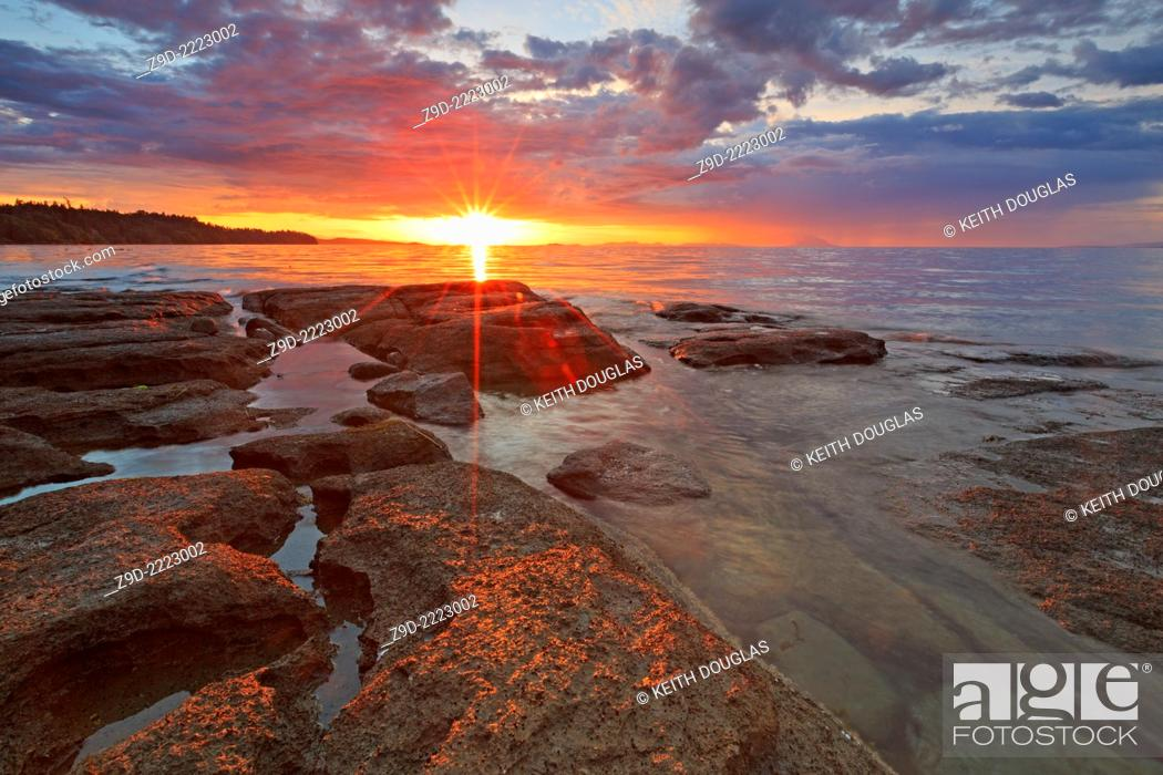 Stock Photo: Sunset over Georgia Strait from beach in north Nanaimo, Vancouver Island, British Columbia.