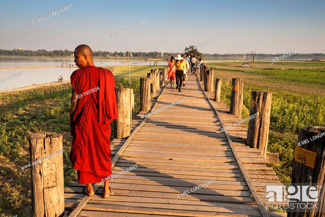 Stock Photo: Buddhist monk standing on U Bein wooden bridge, Taungthaman Lake, Amarapura, Mandalay, Myanmar, (Burma).