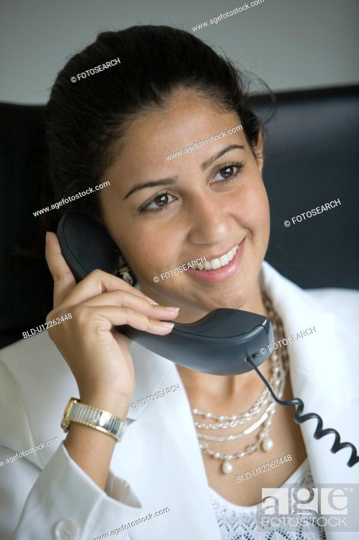 Stock Photo: business, phone, women, woman, Arabic.