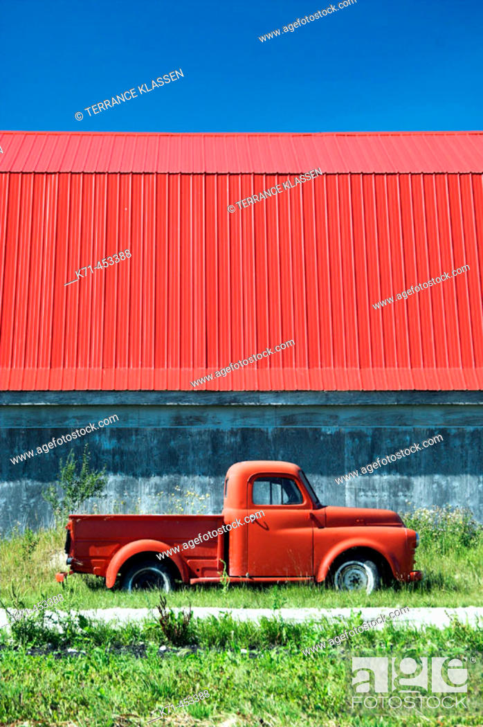 Stock Photo: The color of red in an old truck and barn roof near Isle de Chênes, Manitoba. Canada.