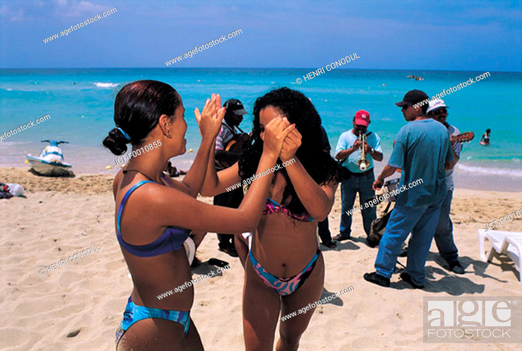 Stock Photo: Eastern beaches, dancing ladies.