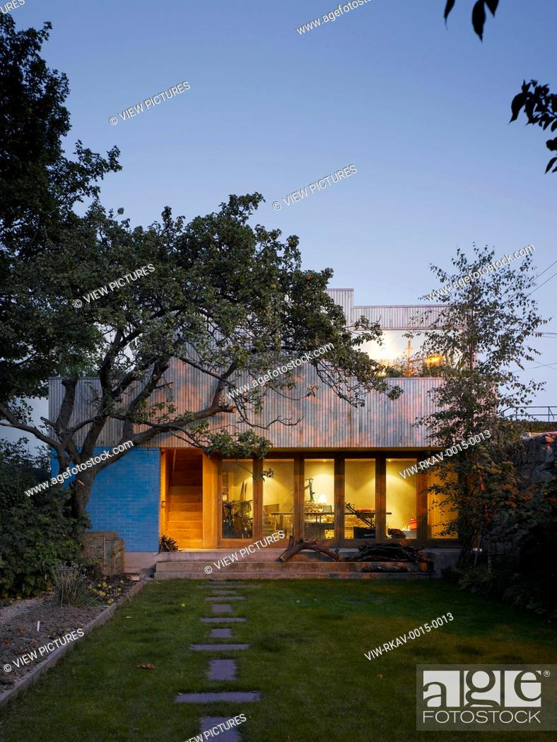 Stock Photo: House Garden Graft, Mews, Loft & Garden, Ranelagh, Ireland. Architect Donaghy + Dimond, 2011. View of mews from garden showing external stairs and internal.