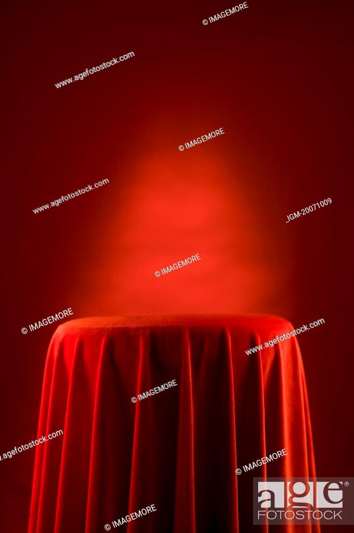 Stock Photo: Table with red velvet cloth.