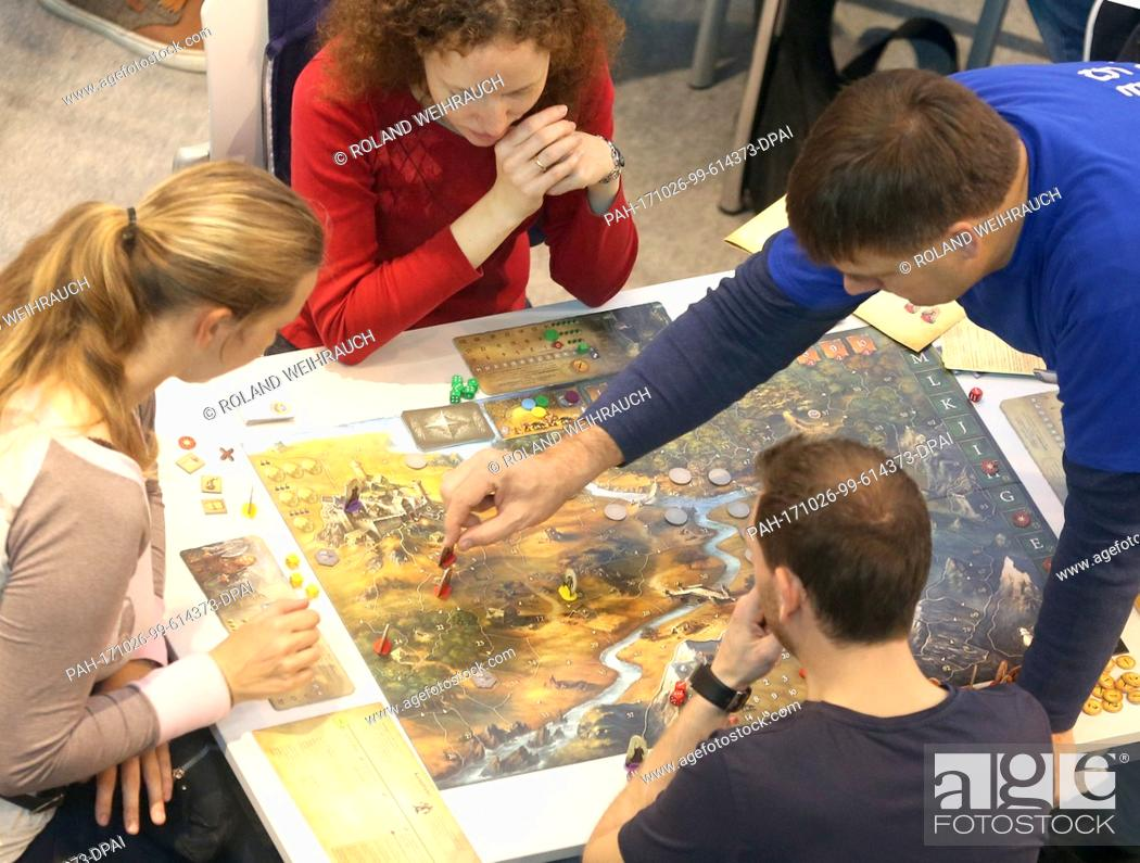 Stock Photo: Visitors play games at the 35th International Game Days expo in Essen, Germany, 26 October 2017. Around 1100 exhibitors are displaying their wares at the show.