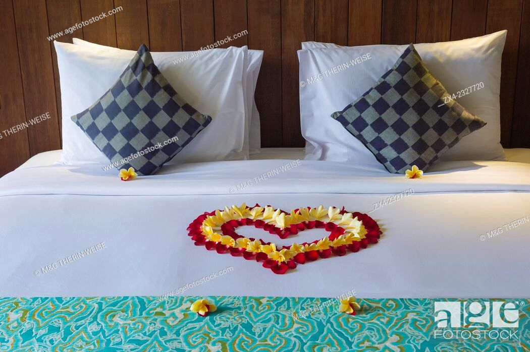 Stock Photo: Hotel bed decorated with flowers petals, Ubud, Bali, Indonesia.