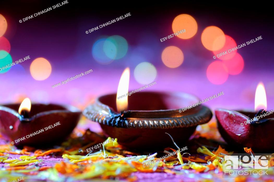 Stock Photo: Clay diya lamps lit during Diwali Celebration. Greetings Card Design Indian Hindu Light Festival called Diwali.