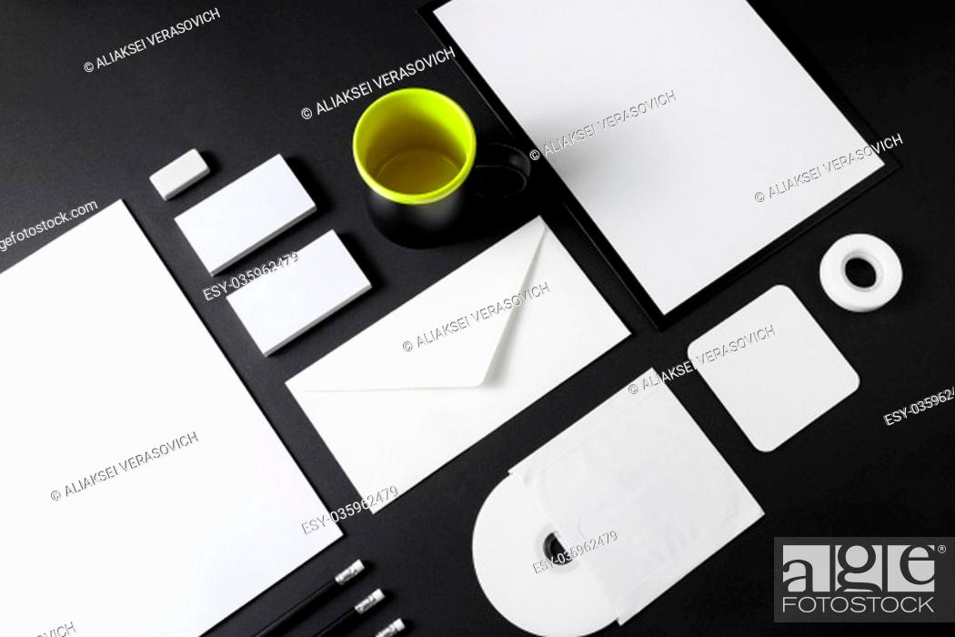 Stock Photo: Blank stationery set on black paper background. Corporate ID mockup. Mock up for branding identity. Responsive design template.