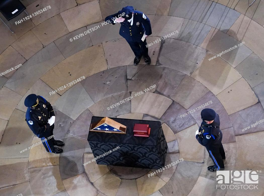 Stock Photo: Mourners pay their respects at the funeral service for Capitol Police Officer Brian Sicknick in Washington, DC on Wednesday, February 3, 2021.