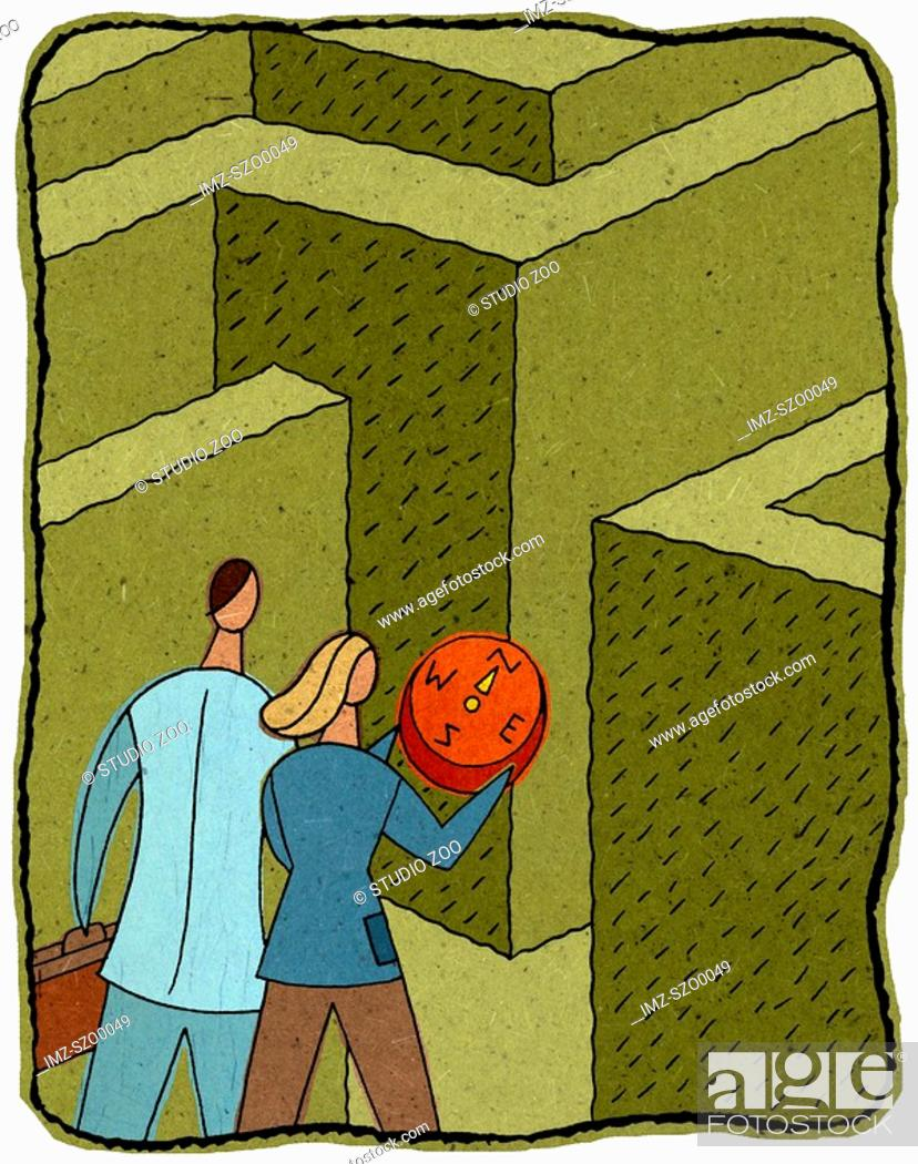 Stock Photo: people with a compass entering a maze.