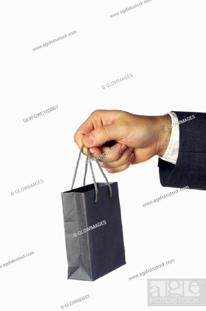 Stock Photo: Close-up of a businessman holding a shopping bag.