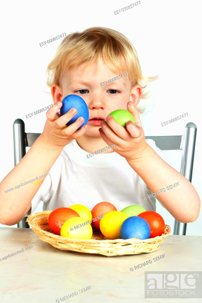 Stock Photo: portrait of little girl with Easter eggs.