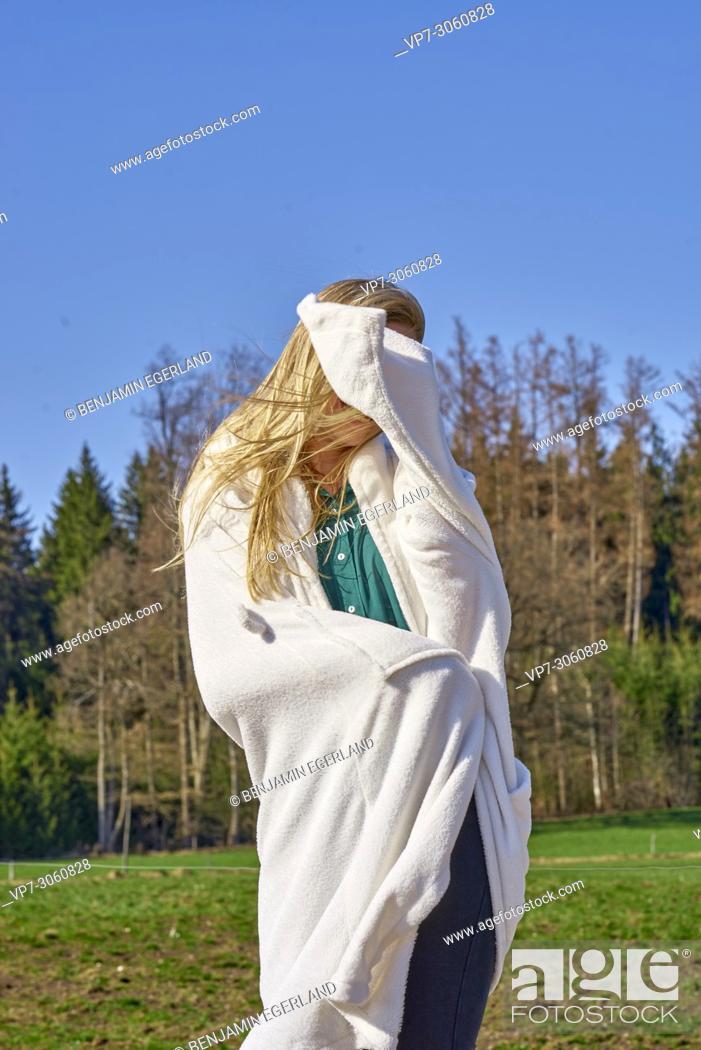 Stock Photo: Portrait of woman in nature wearing a white bathrobe. Waakirchen, Bavaria, Germany.