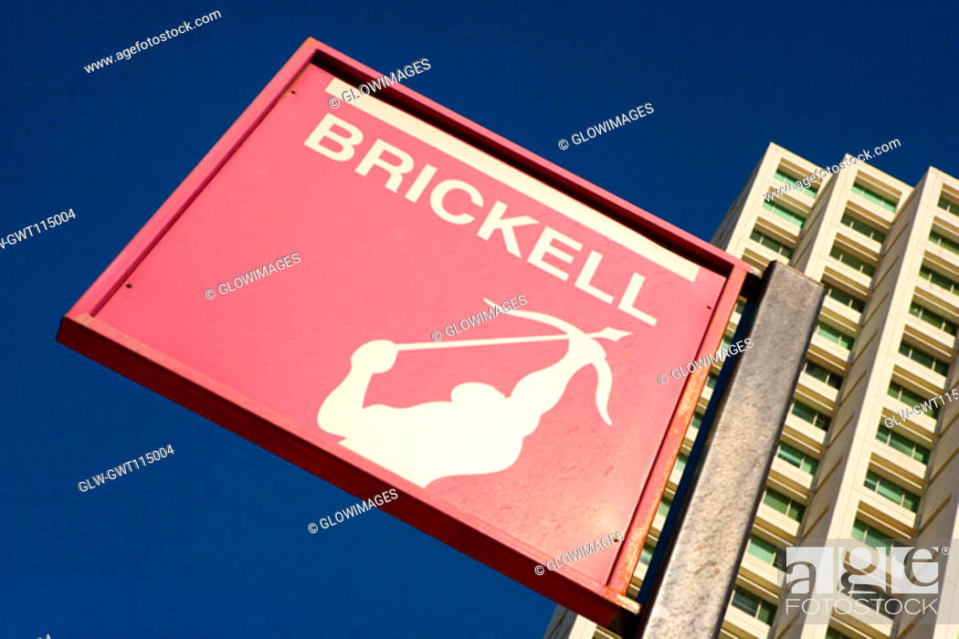 Stock Photo: Low angle view of a sign board in front of a building, Miami, Florida, USA.