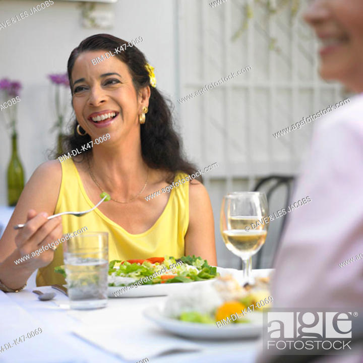 Stock Photo: Woman eating at restaurant.