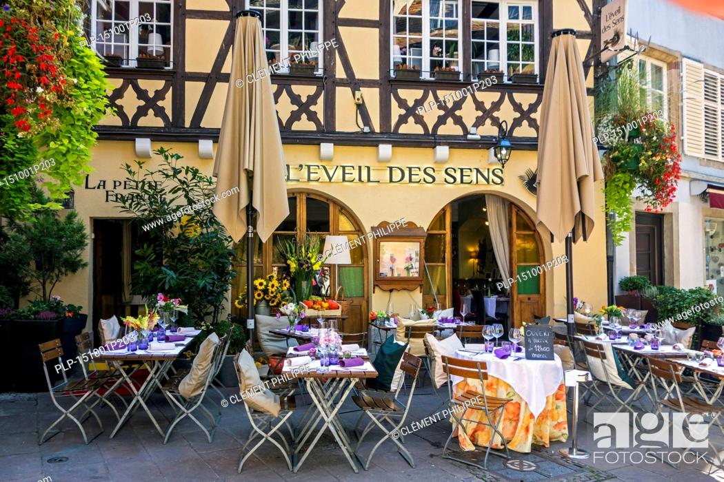 Stock Photo: Laid tables outside in front of restaurant L'Eveil des Sens in the city Strasbourg, Alsace, France.
