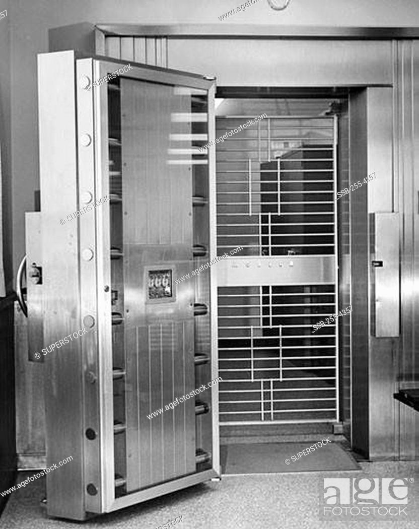 Stock Photo: Open door of bank vault.