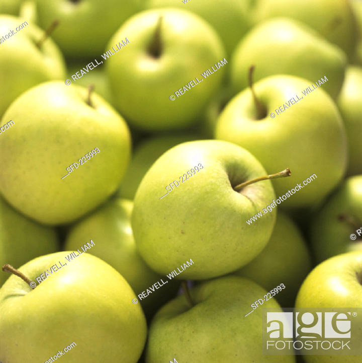Stock Photo: Green Golden Delicious apples (filling the picture).