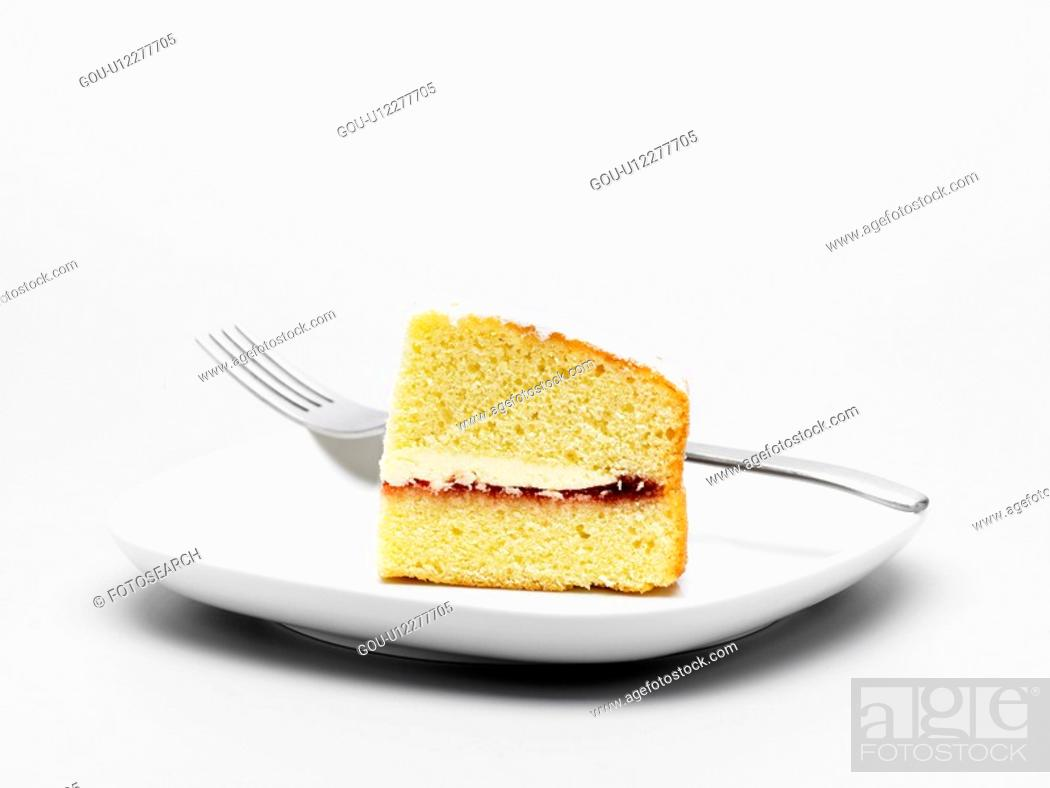 Stock Photo: Slice of cake on plate (close-up).