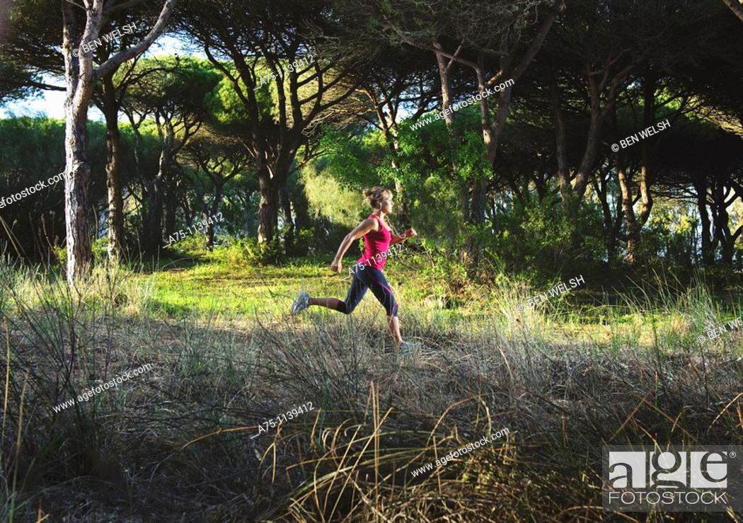 Stock Photo: Woman jogging in forest.
