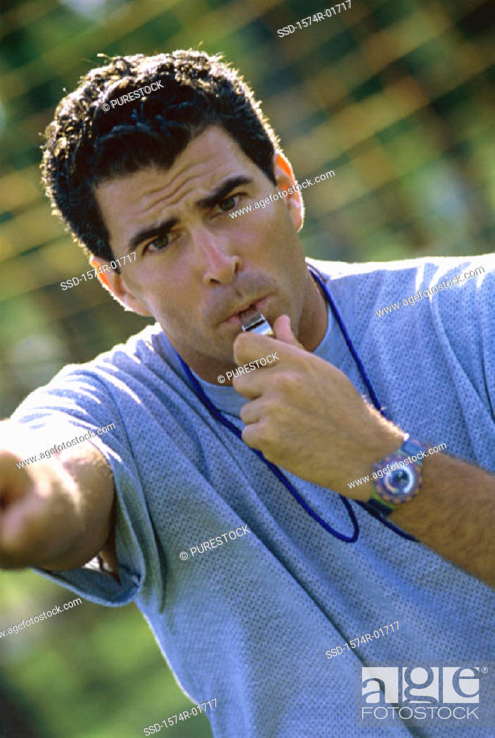 Stock Photo: Portrait of a coach blowing a whistle.