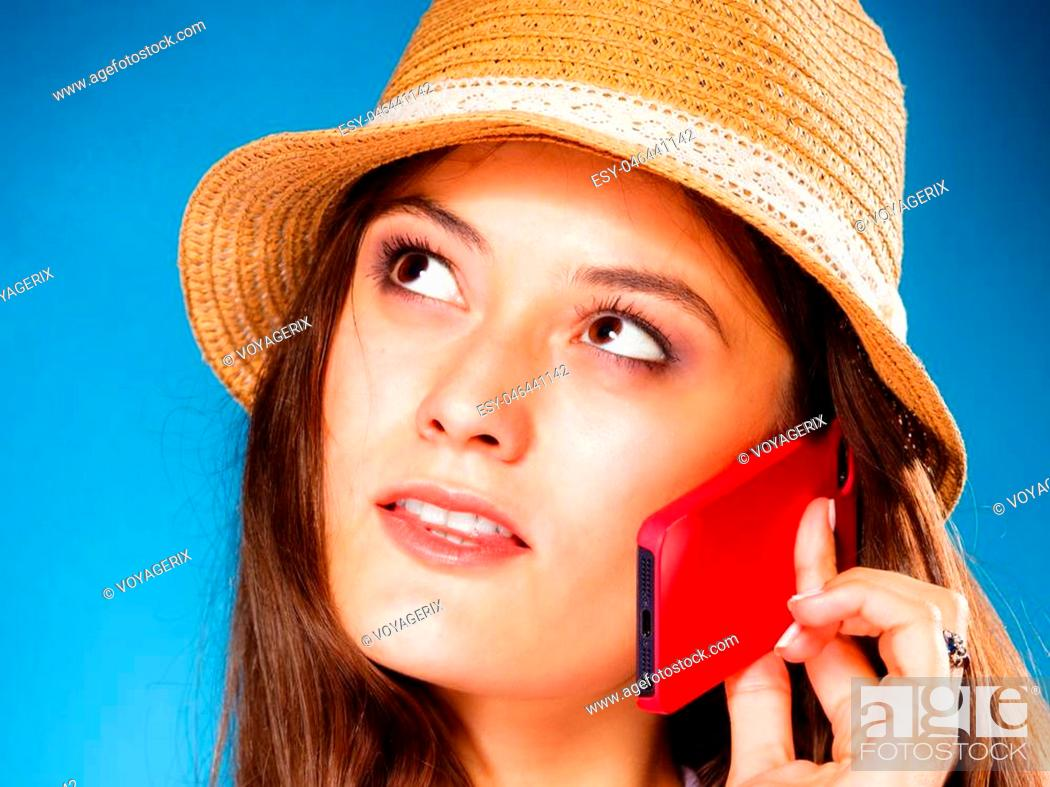 Imagen: Technology and communication - teen girl talking on mobile phone smartphone, lovely woman using cell phone on blue.