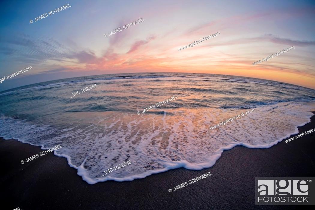 Stock Photo: Sunset over the Gulf of Mexico from Venice Beach Florida.