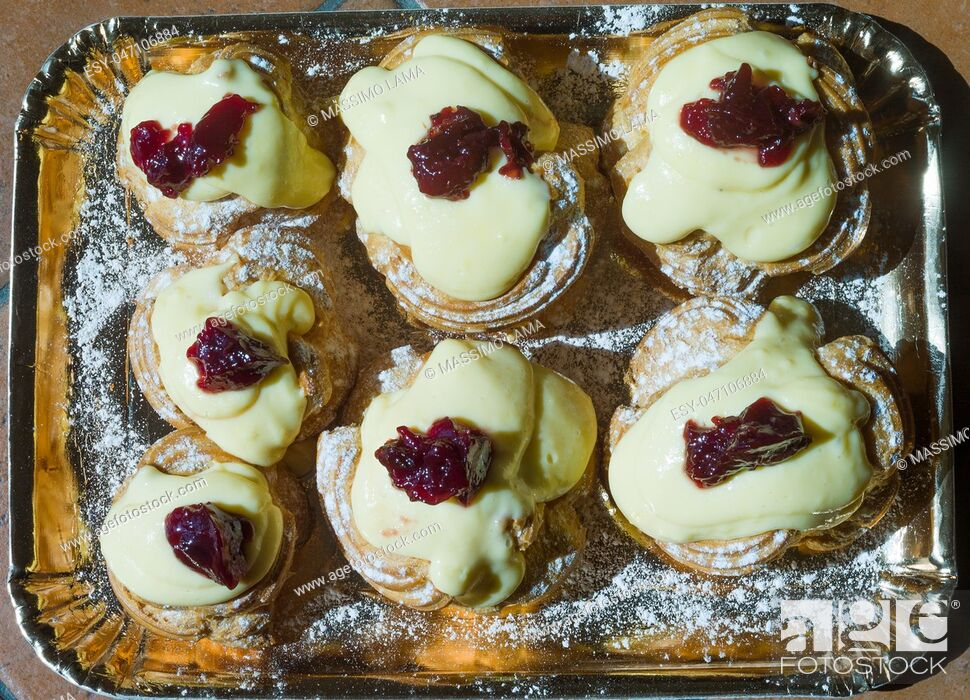 Stock Photo: Zeppole of Saint Joseph, Italian pastry with flour, sugar, eggs, oil, decorated with a sour cherry. Father's Day cake.