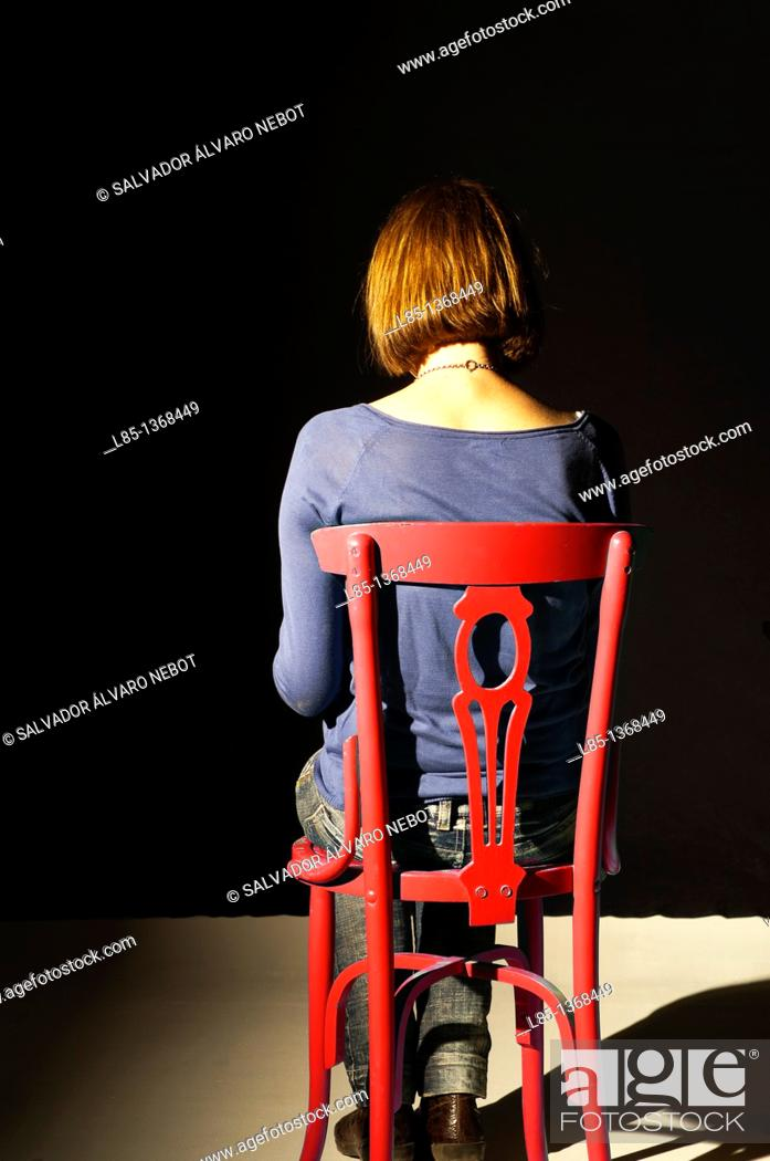 Stock Photo: Girl sitting with her back.
