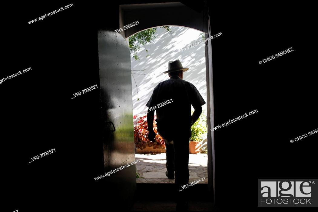 Stock Photo: Antonio Mulero, owner of Los Tamayos organic farm, leaves a room in Prado del Rey, Cadiz, Andalusia, Spain, June 24, 2013.