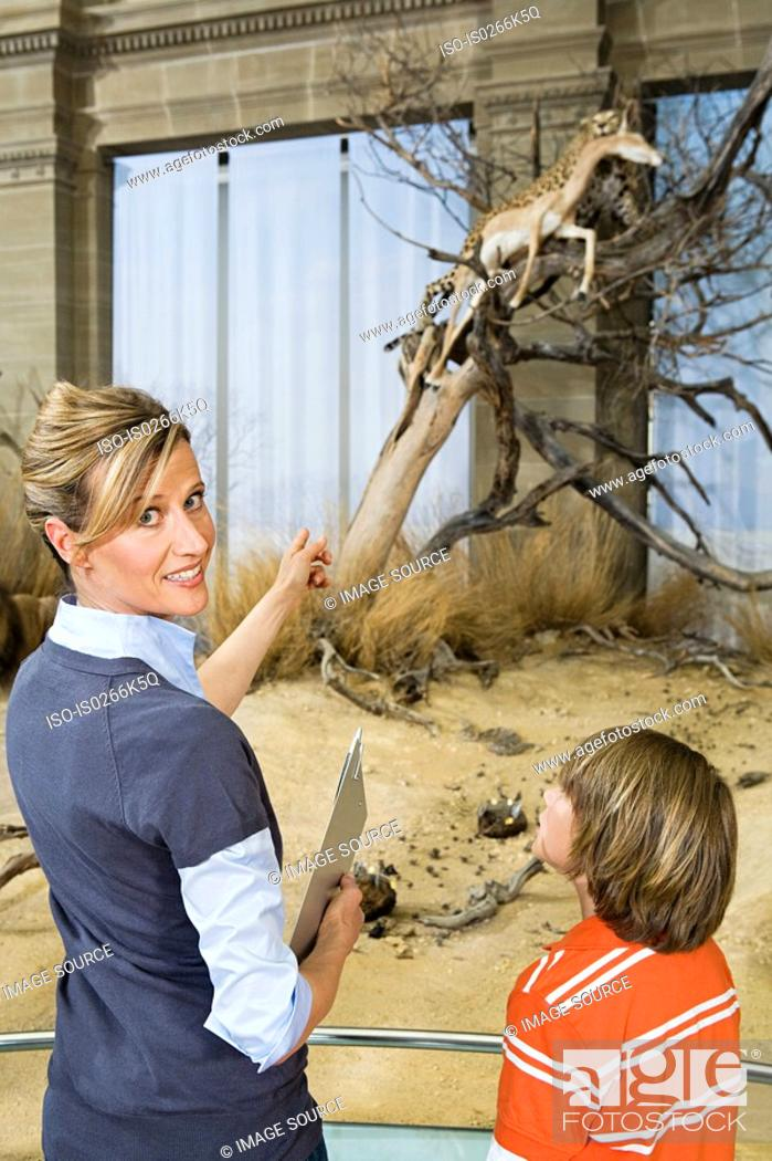 Stock Photo: Teacher and pupil at a museum.