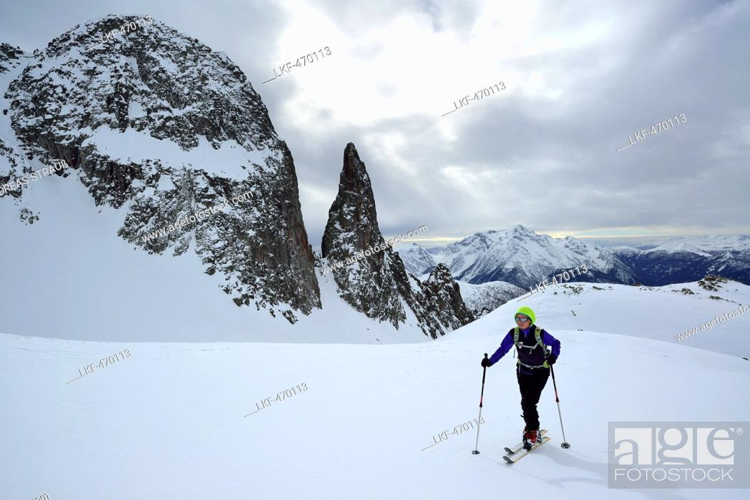 Stock Photo: Female back-country skier ascending to Cima Cece, Lagorai, Fiemme Mountains, Trention, Italy.