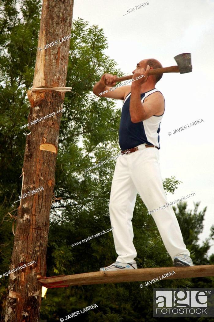 Stock Photo: 'Aizkolari' cutting tree trunk, Basque rural sport, Hondarribia. Guipuzcoa, Basque Country, Spain.
