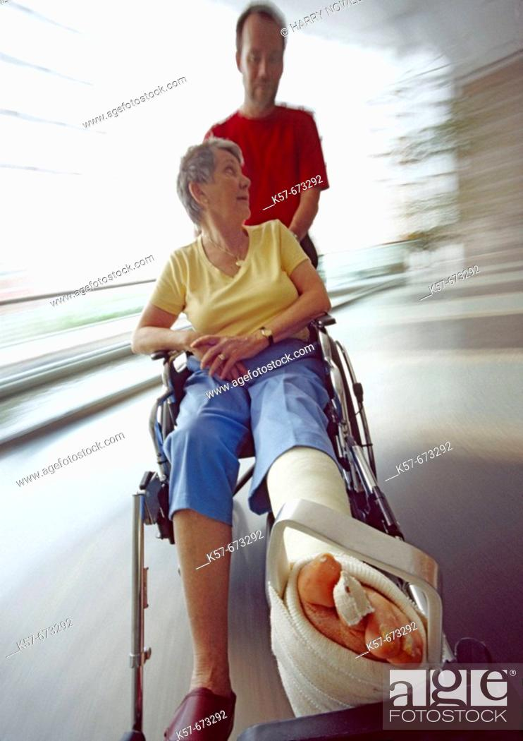 Stock Photo: Senior woman recovering in a hospital wheelchair.