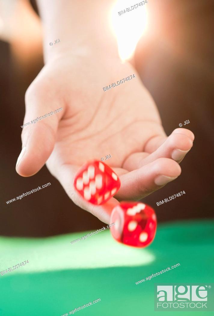 Stock Photo: Woman throwing dice.