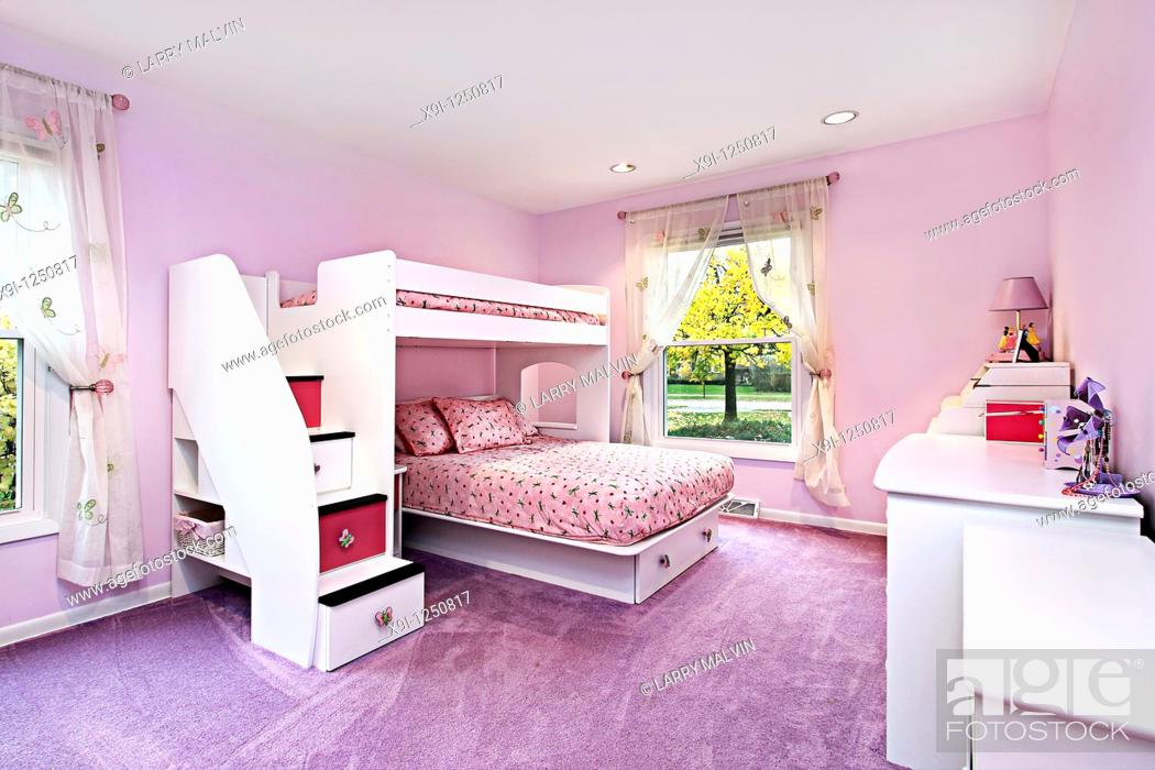 Stock Photo: Girl's room in suburban home with bunk bed.