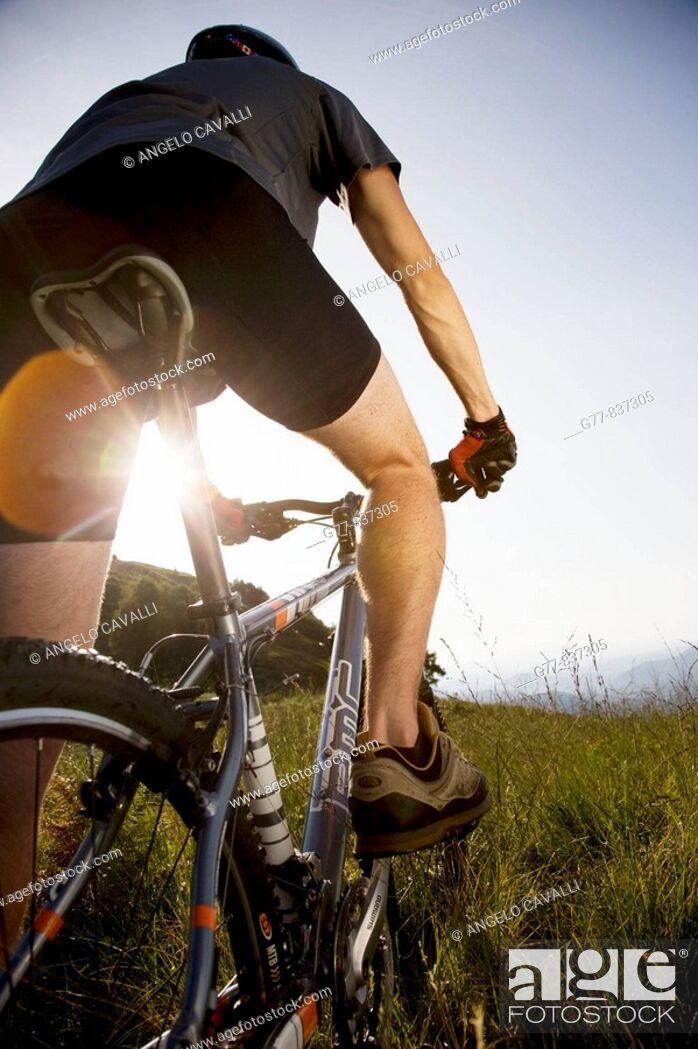 Stock Photo: Italy, Pedimont, Lake Maggiore. Young man on mountain bike.