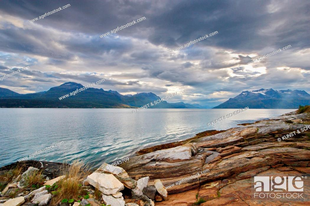 Stock Photo: Clouds are towering over Salangen-Fjord and island Andørjain northern Norway.