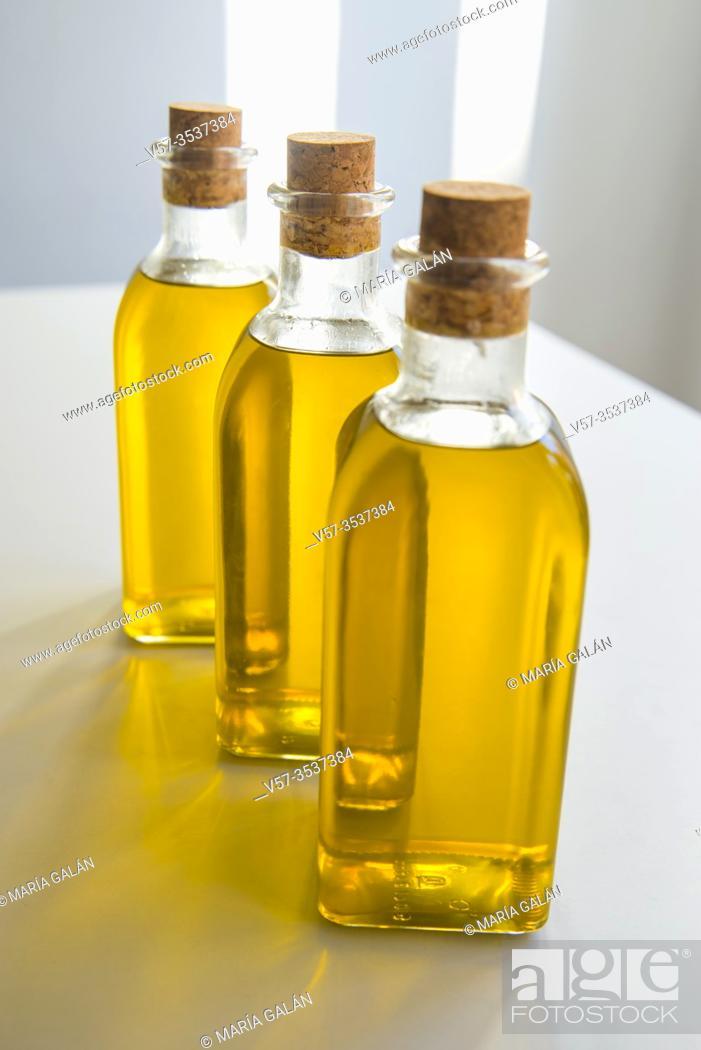 Imagen: Three oil bottles with olive oil. Spain.