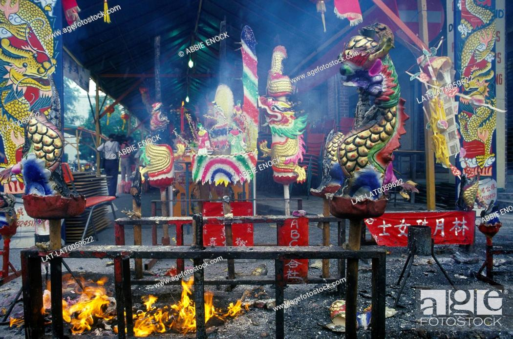 Stock Photo: Chinese festival. Awning. Paper models of dragons. Red banners. Fire. Ash. Smoke haze. Candle holders.