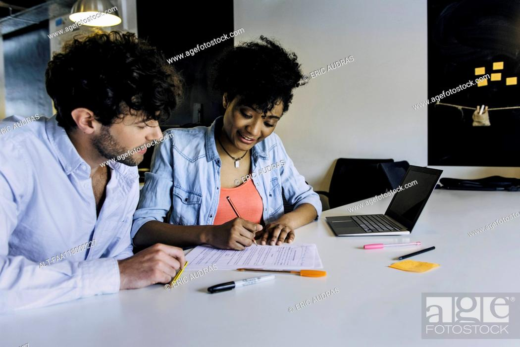 Stock Photo: Business people working in office.