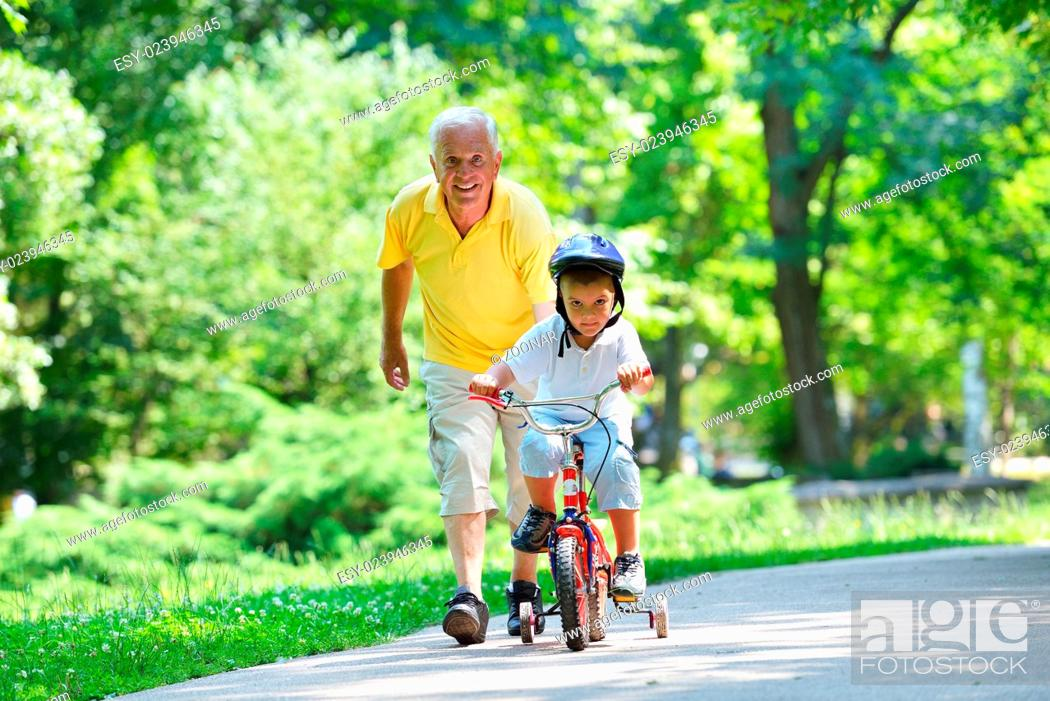 Stock Photo: happy grandfather and child in park.
