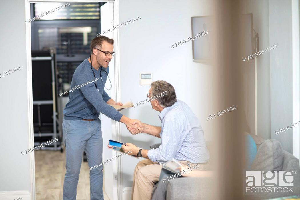 Stock Photo: Doctor shaking hands with patient in medical practice.