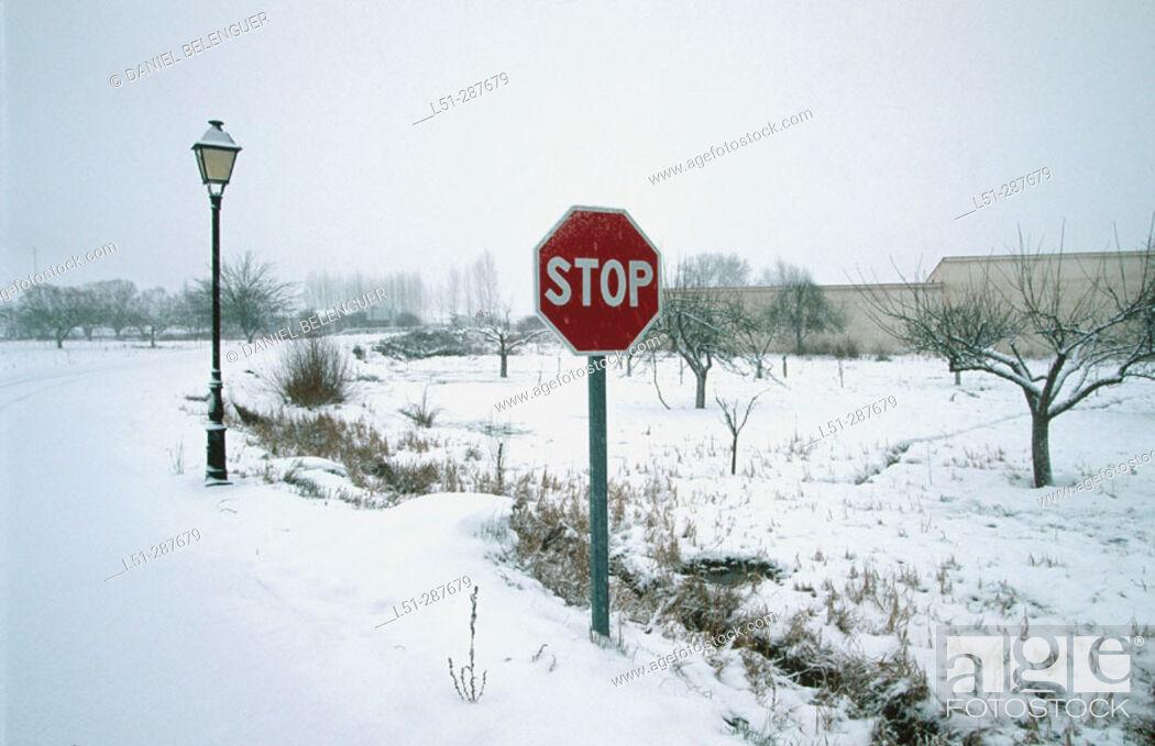 Stock Photo: Snow covered traffic sign. Tragacete, Serranía de Cuenca. Cuenca province, Spain.