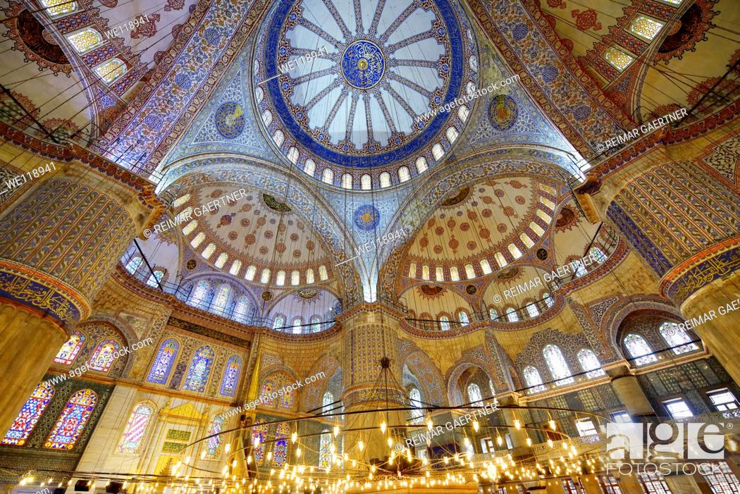Stock Photo: Interior of the Blue Mosque Istanbul Turkey with Iznik tiles and stained glass windows.