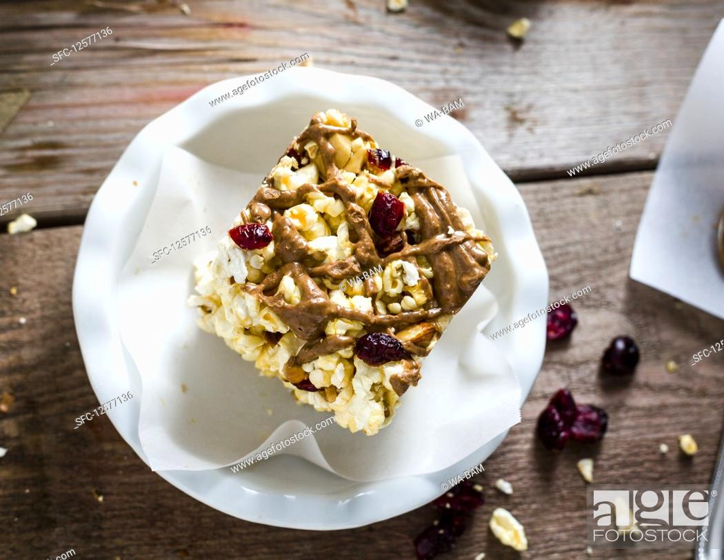 Stock Photo: Popcorn breakfast bar with almonds, cranberries and almond butter.