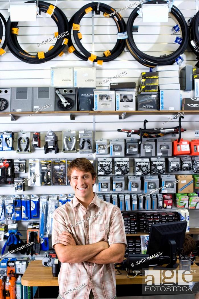 Stock Photo: Storekeeper in shop, smiling, portrait.
