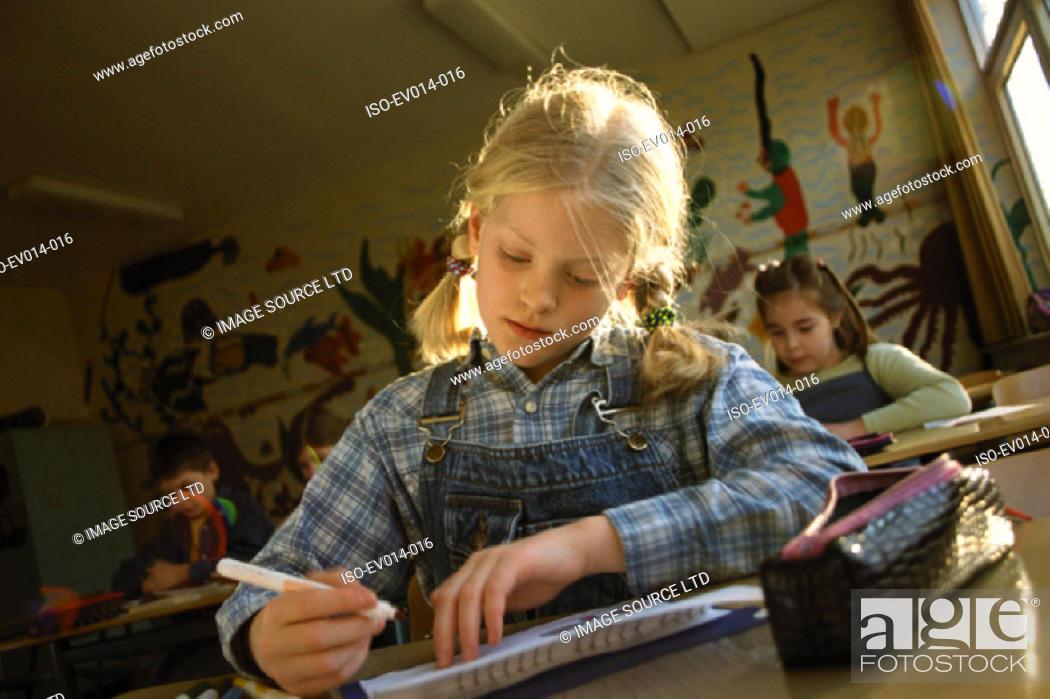 Stock Photo: Girl in class.