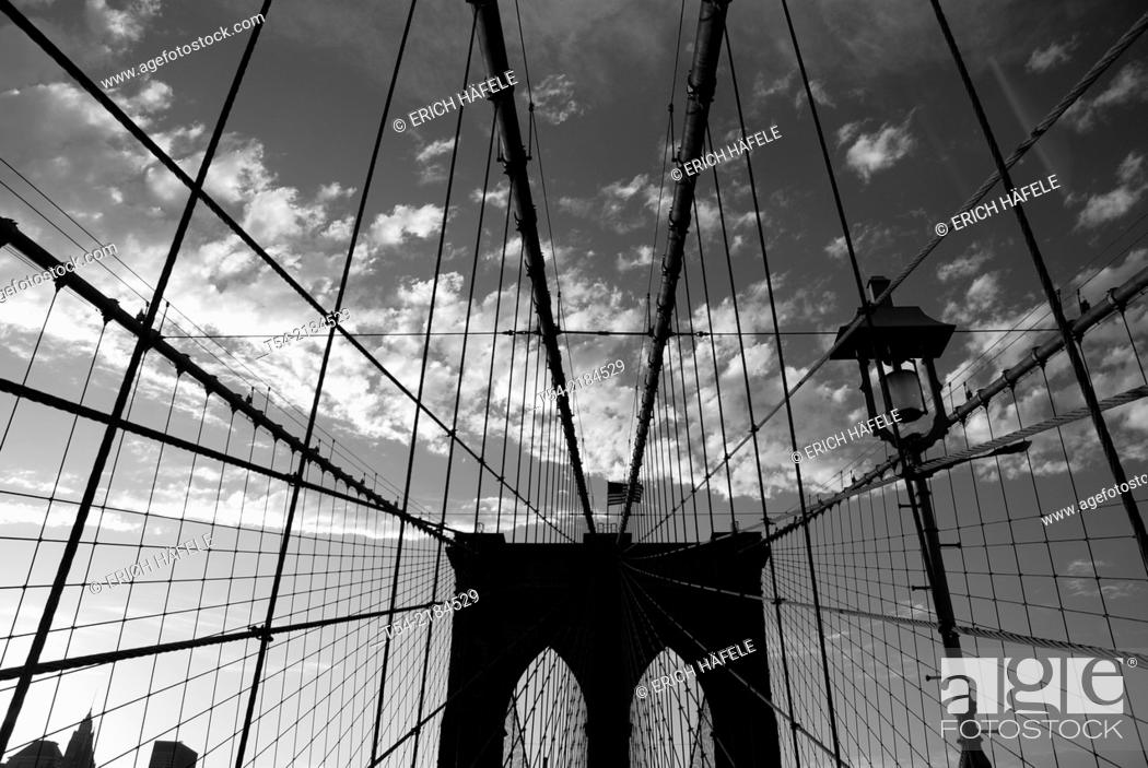 Stock Photo: Brooklyn Bridge in New York at Sunset.