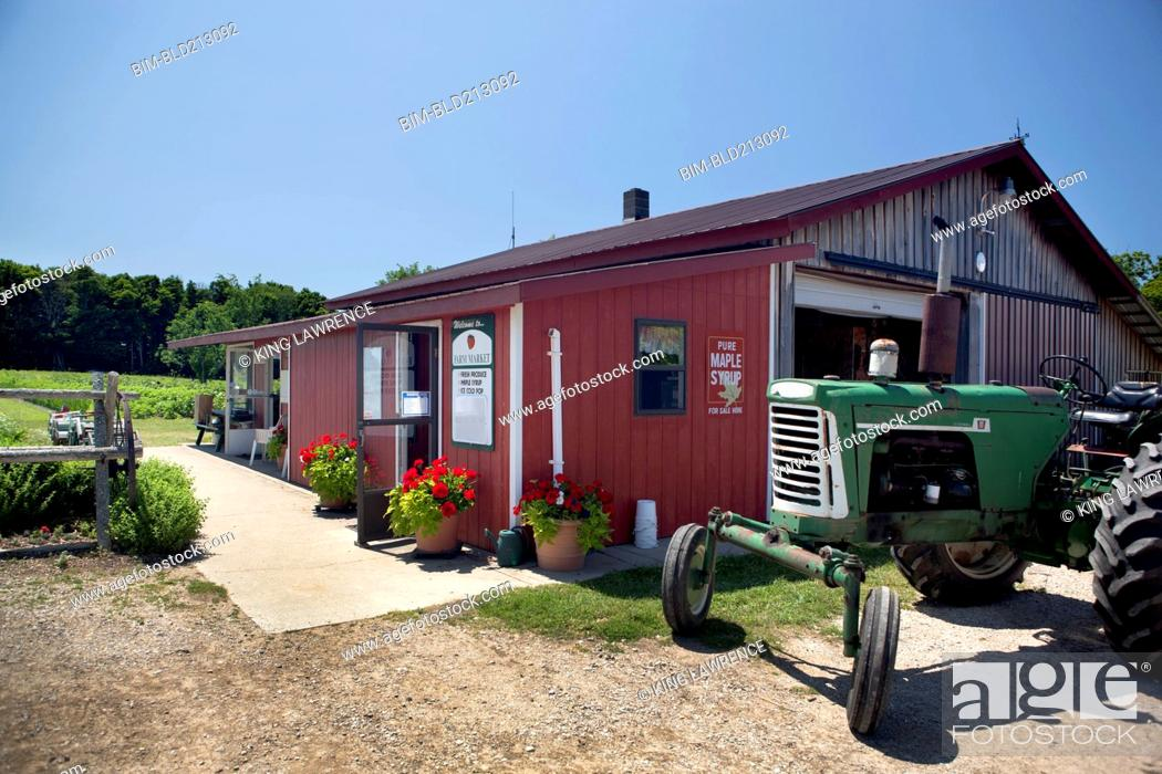 Stock Photo: Tractor outside rural farm store.