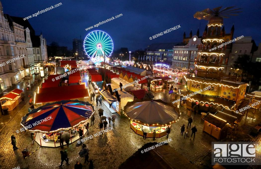 Stock Photo: View of the Christmas market with visitors after its opening in Rostock, Germany, 27 November 2017. About 1.5 million visitors are expected for the largest.